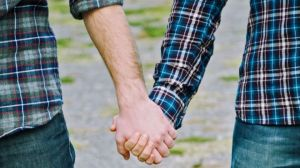 Gay couple holding hands istock