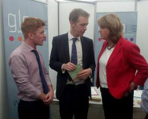 GLEN's Craig Dwyer & Tiernan Brady chat with Tánaiste Joan Burton at the National Ploughing Championships [Image: GLEN/Facebook]