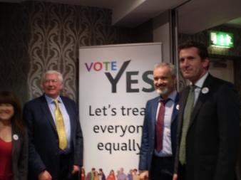 One woman, three men, standing. From Left To Right: Tara Flynn, Sean Kenny TD, Colm O'Gorman (Amnesty) and Aodhán Ó Riordáin TD