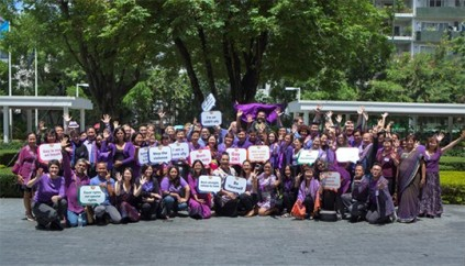 asia pacific students wearing purple for anti-bullying campaign