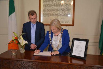 Kieran Rose joins The Lord Mayor of Dublin, Críona Ní Dhálaigh, to sign the Book of Condolence for Orlando victims