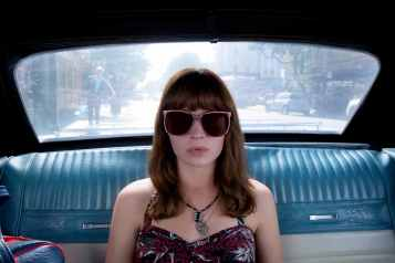 girl in car with sunglasses