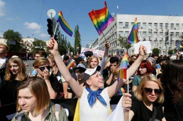 crowd at gay march in kiev with flags