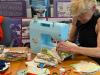 US: Volunteers sew AIDS Memorial Quilt fabric into coronavirusmasks